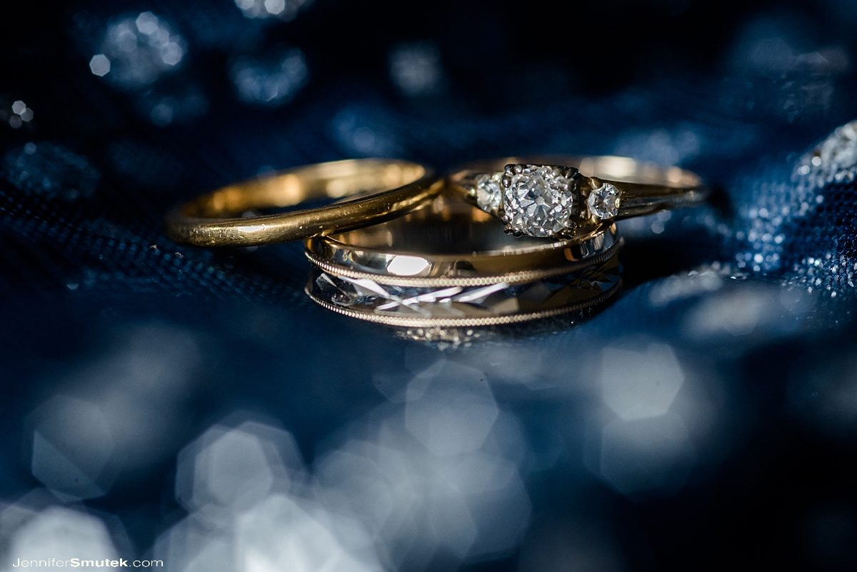 wedding rings on a blue wedding gown