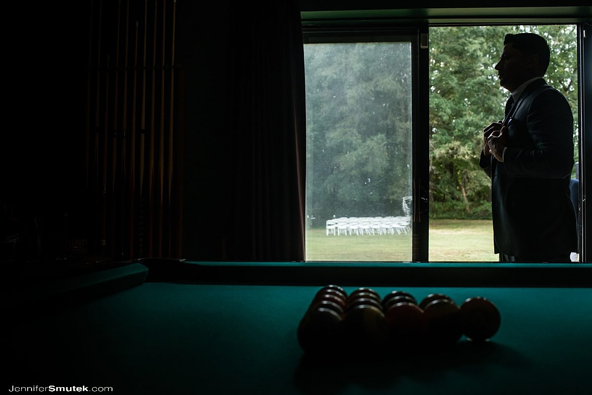 groom getting ready near pool table