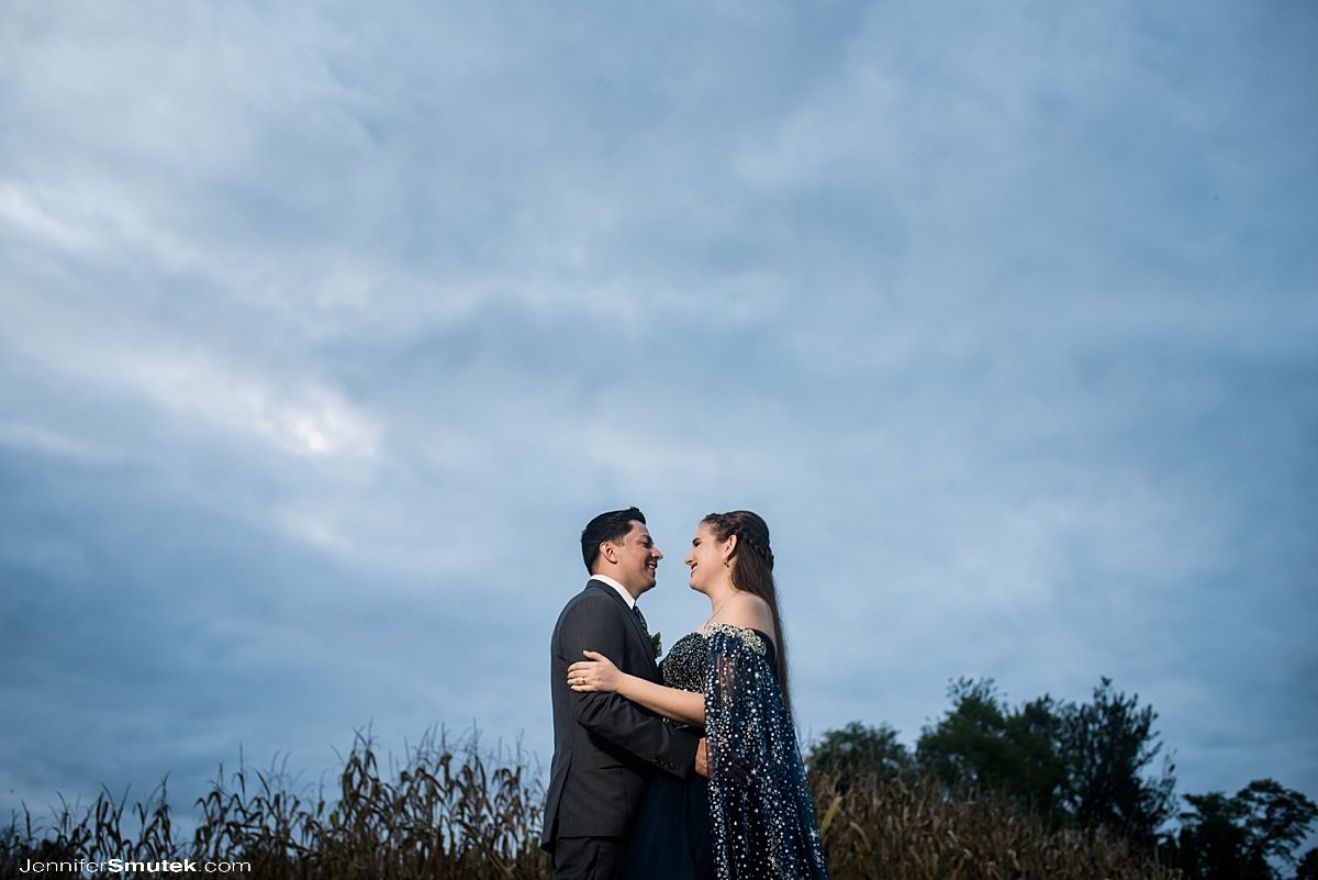 couple lit with magmod in front of a cloudy blue sky