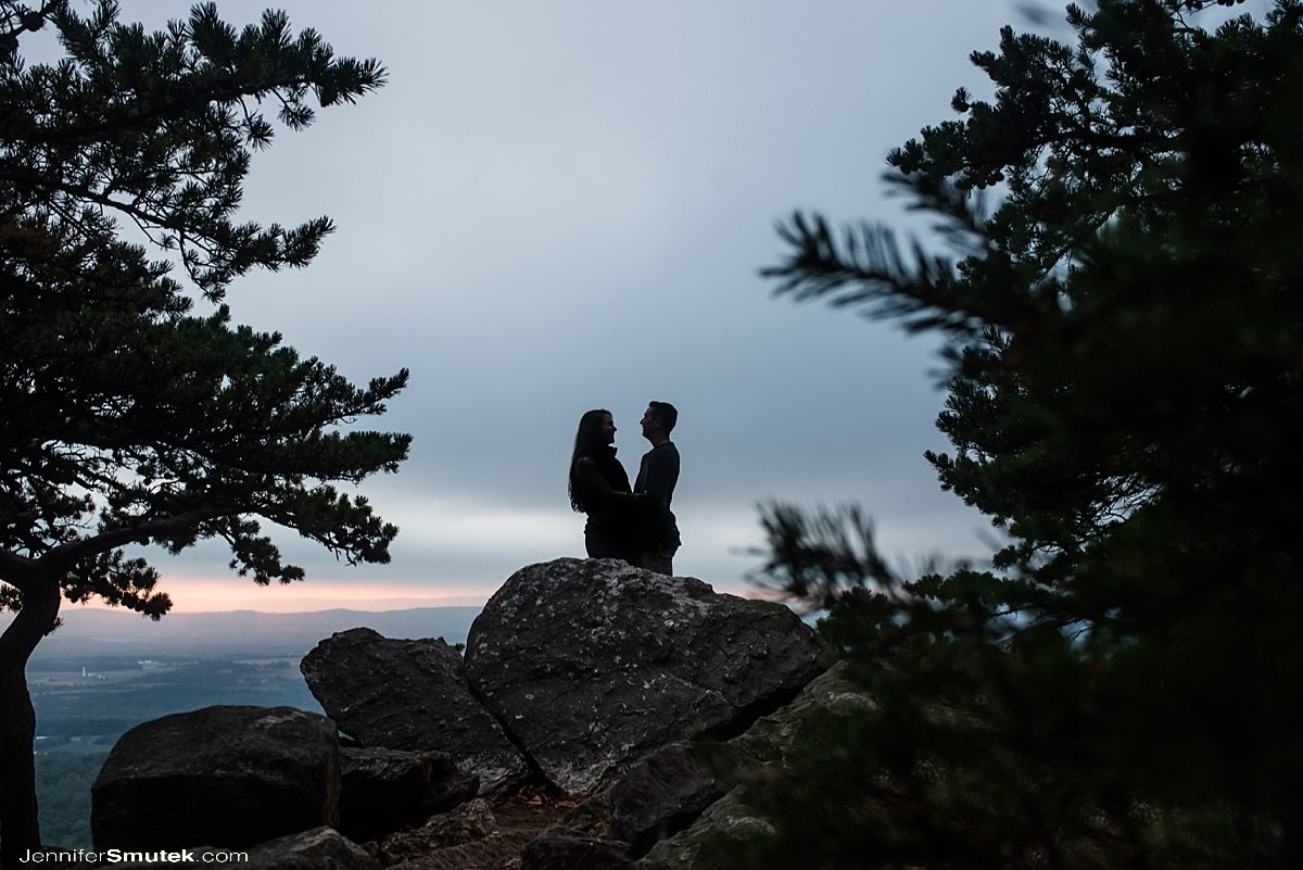 couple embracing during sugarloaf mountain engagement session