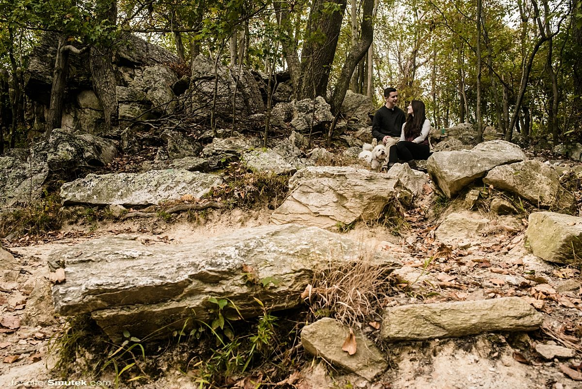 couple sitting on rocks sugarloaf mountain engagement session