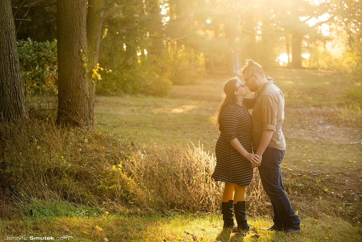 couple standing outside fall loch raven engagement session