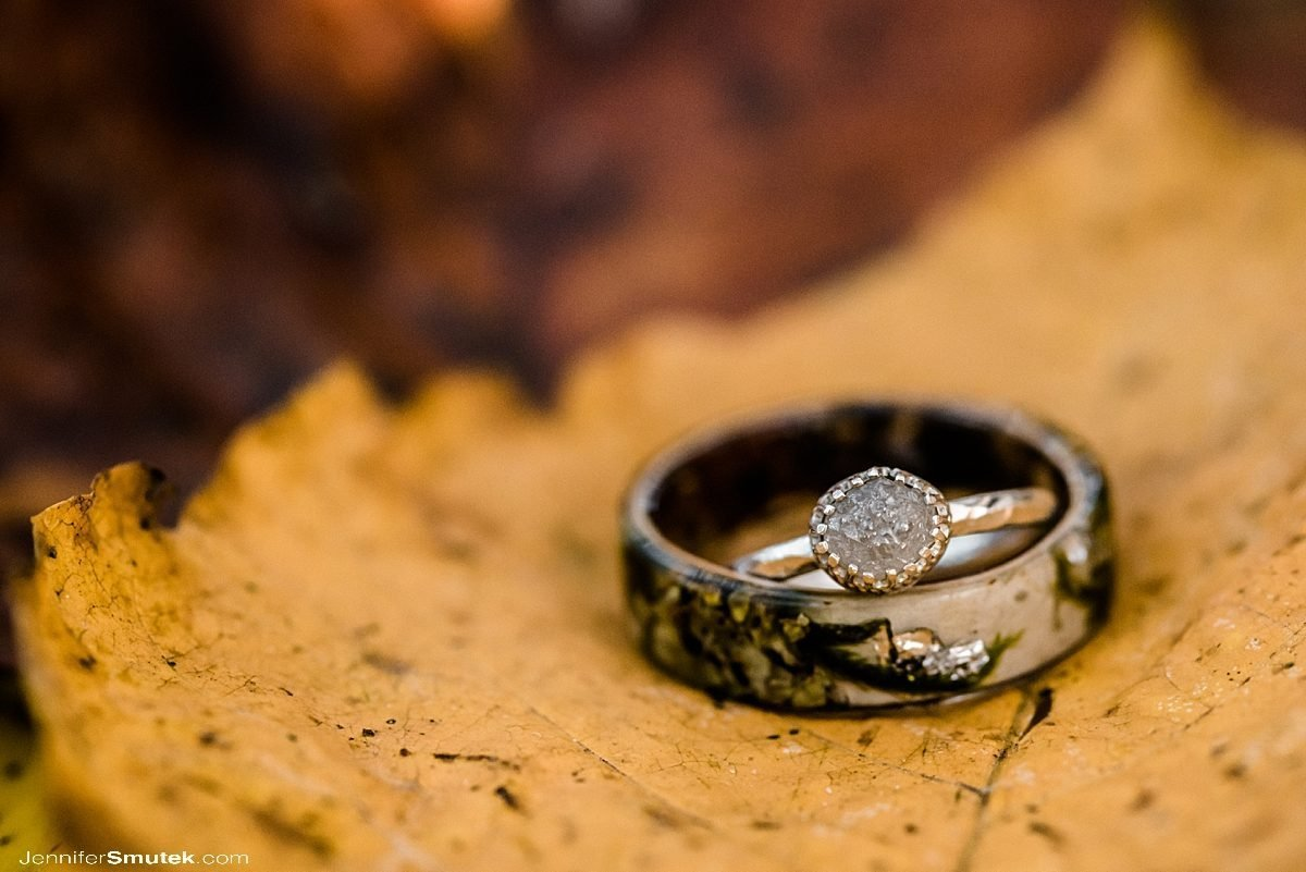 wedding rings on fall leaves Fall Loch Raven Engagement Session