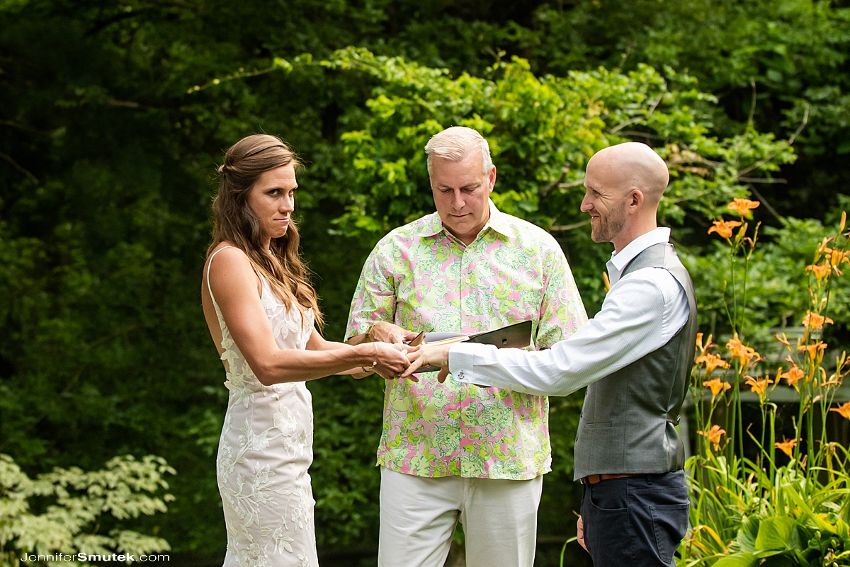 bride having trouble getting ring on groom's finger