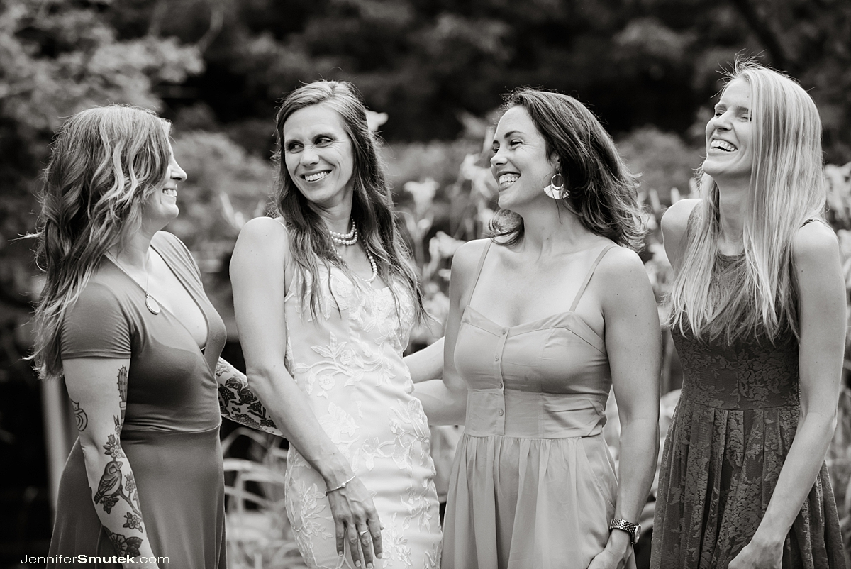 bride and bridesmaids laughing backyard covid-19 wedding maryland