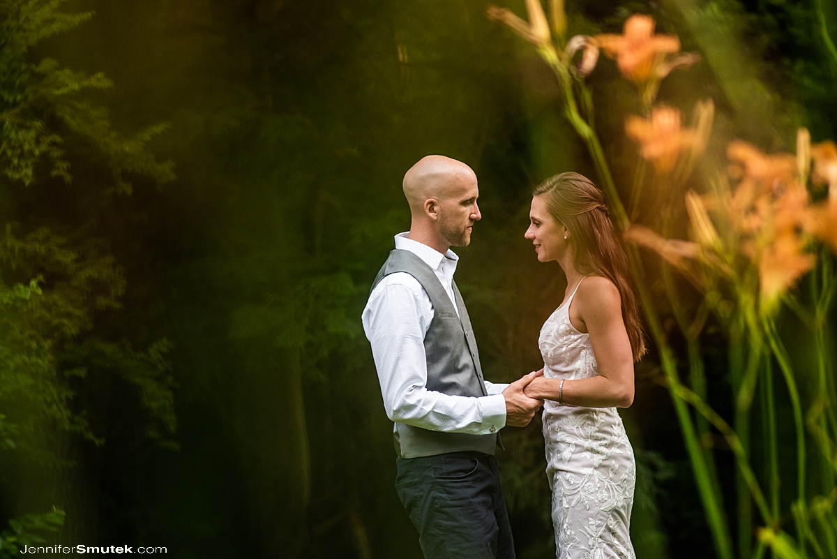 photo of bride and groom holding hands in a backyard garden wedding during covid-19