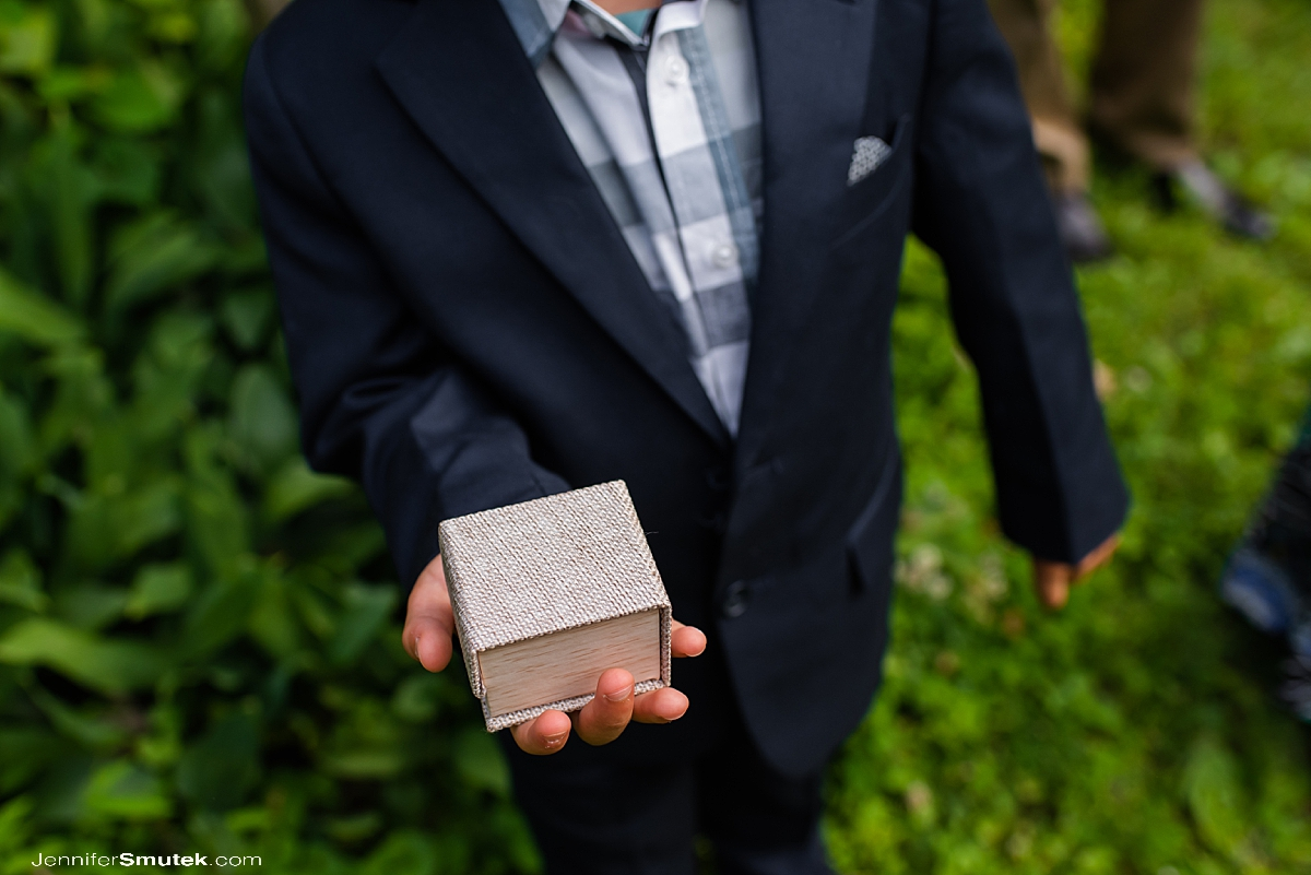 ring bearer holding ring box at a socially distant wedding in baltimore