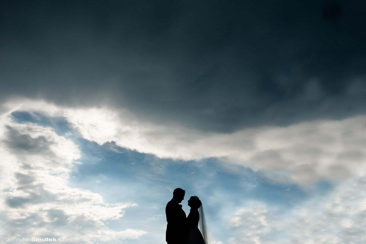 bride and groom on wedding day in the clouds baltimore maryland