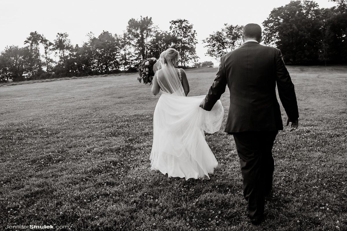 bride and groom walking backyard wedding maryland