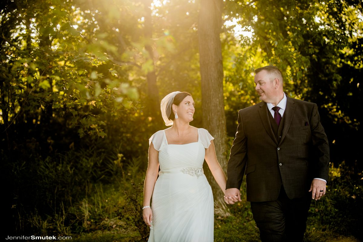 micro weddings in baltimore maryland bride and groom walking with the sun behind them