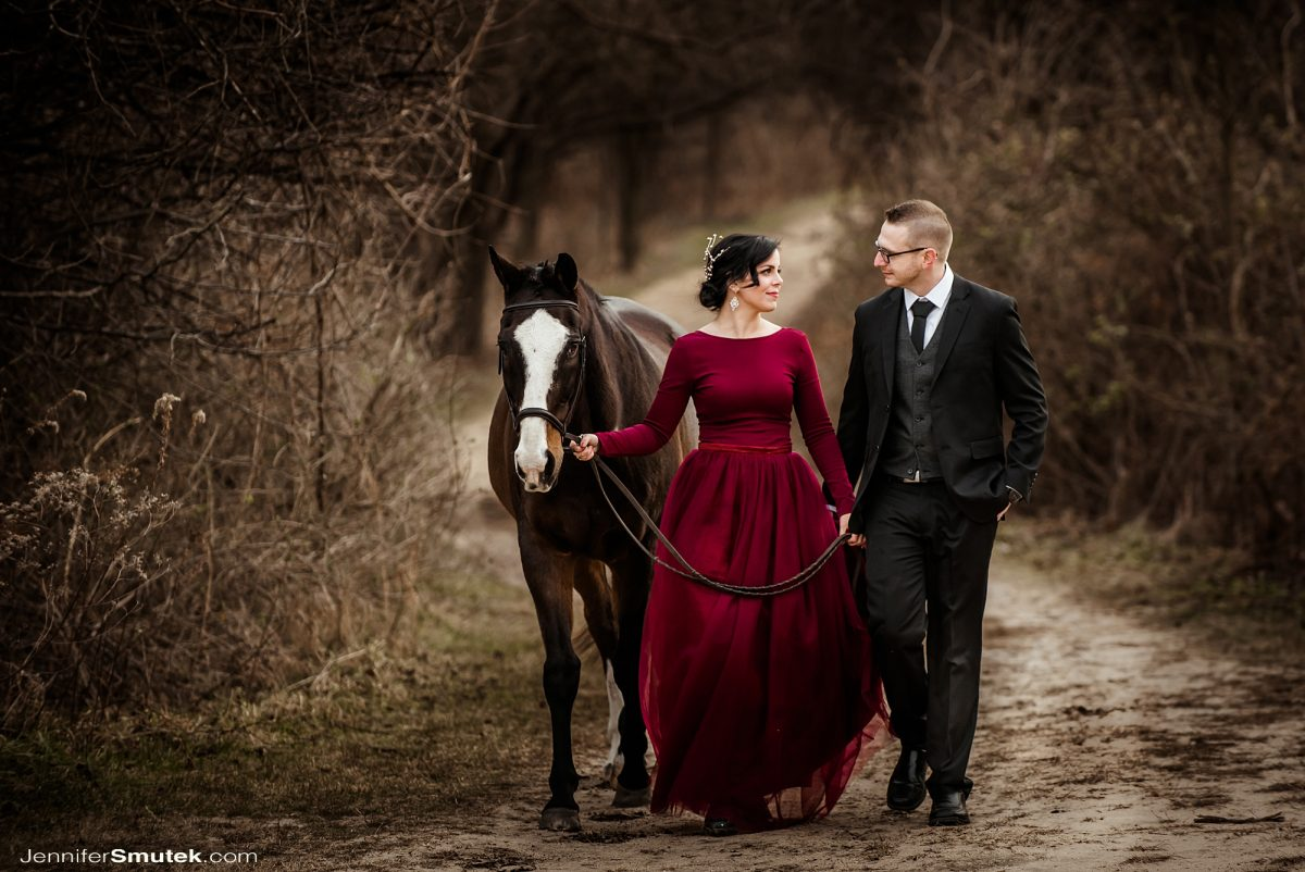 small wedding in baltimore maryland with a horse and red wedding gown