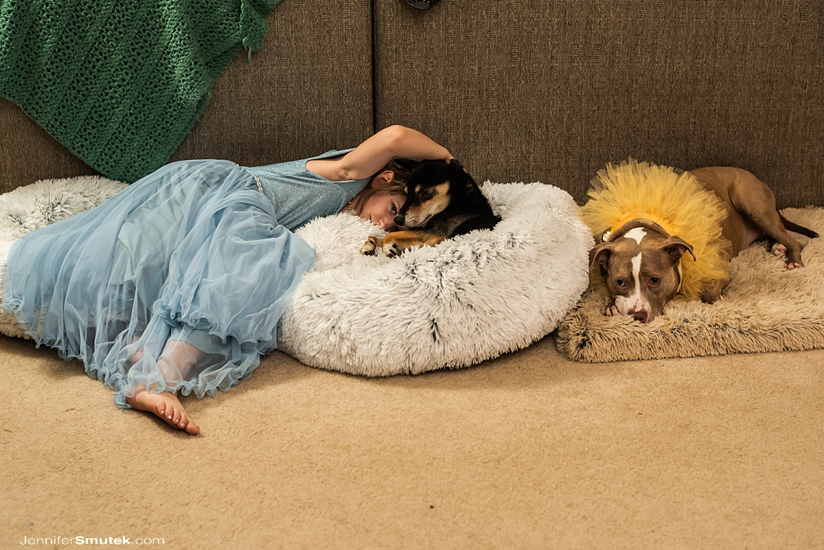 flower girl laying in dog bed with flower dogs