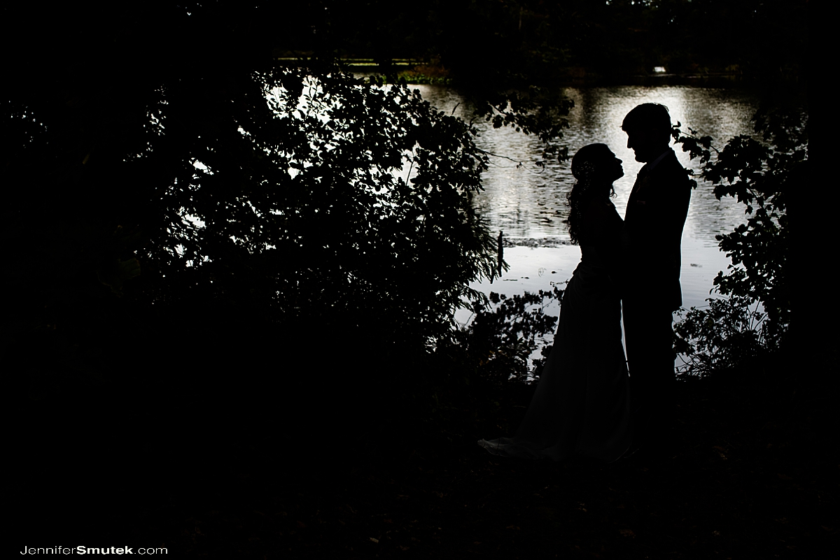 silhouette photo of bride and groom on the water