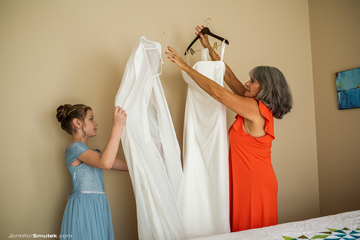 mother of bride and flower girl getting dress down