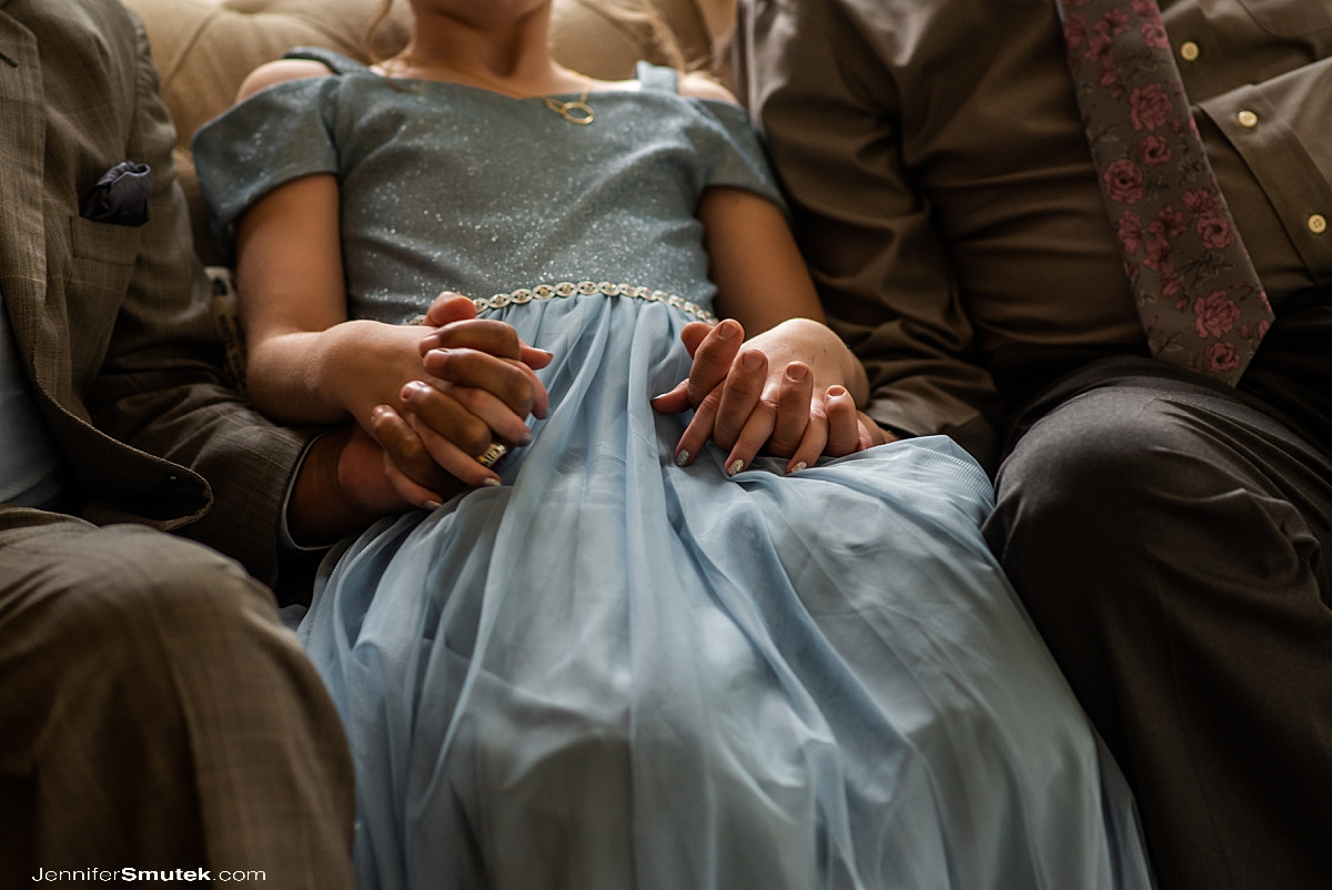flower girl holding hands with grandfathers