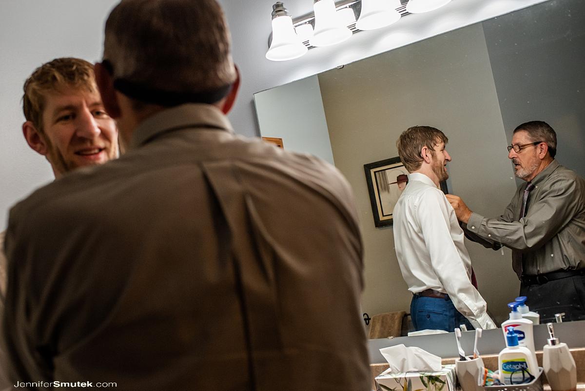 dad helping groom get ready