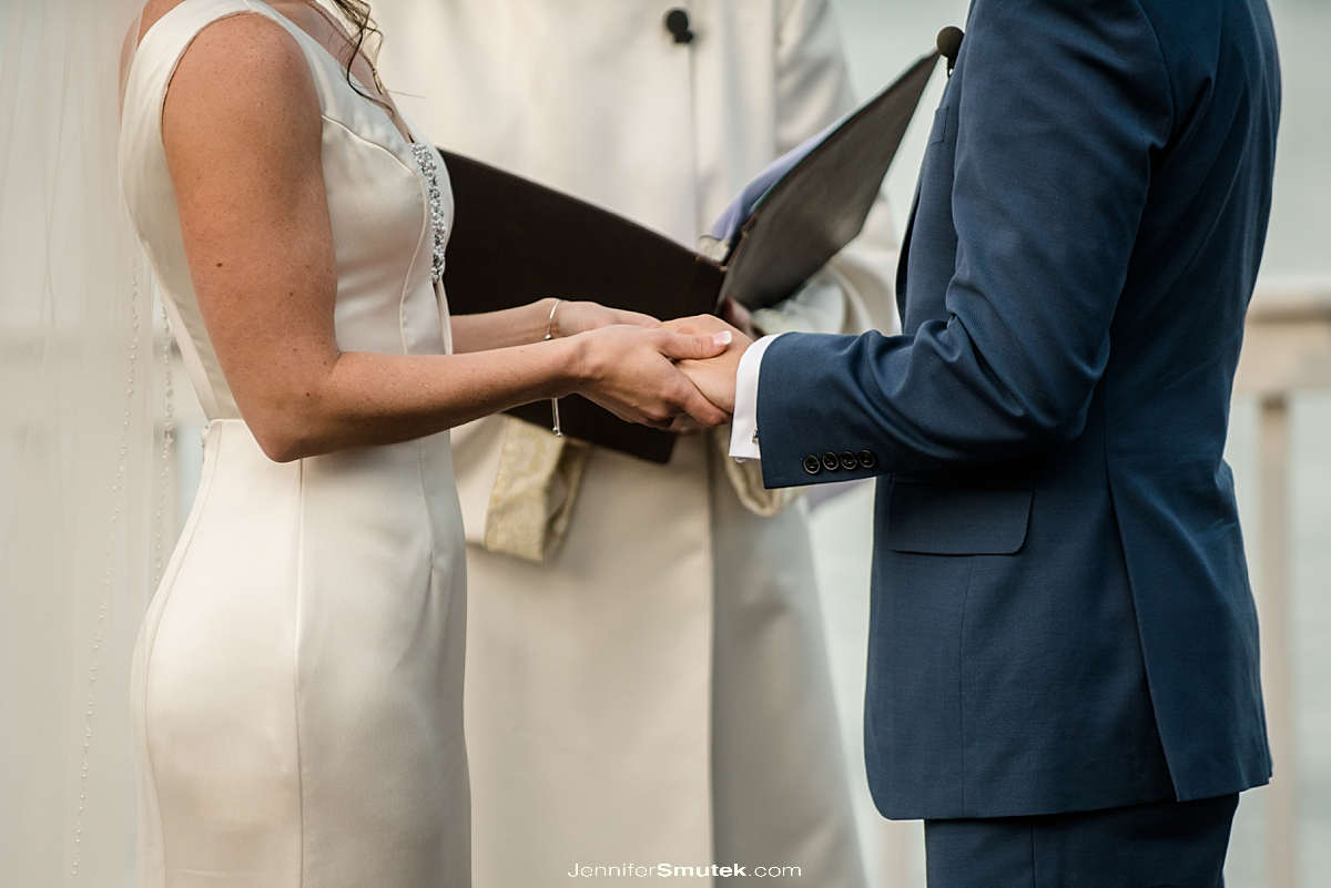 close up of bride and groom hands