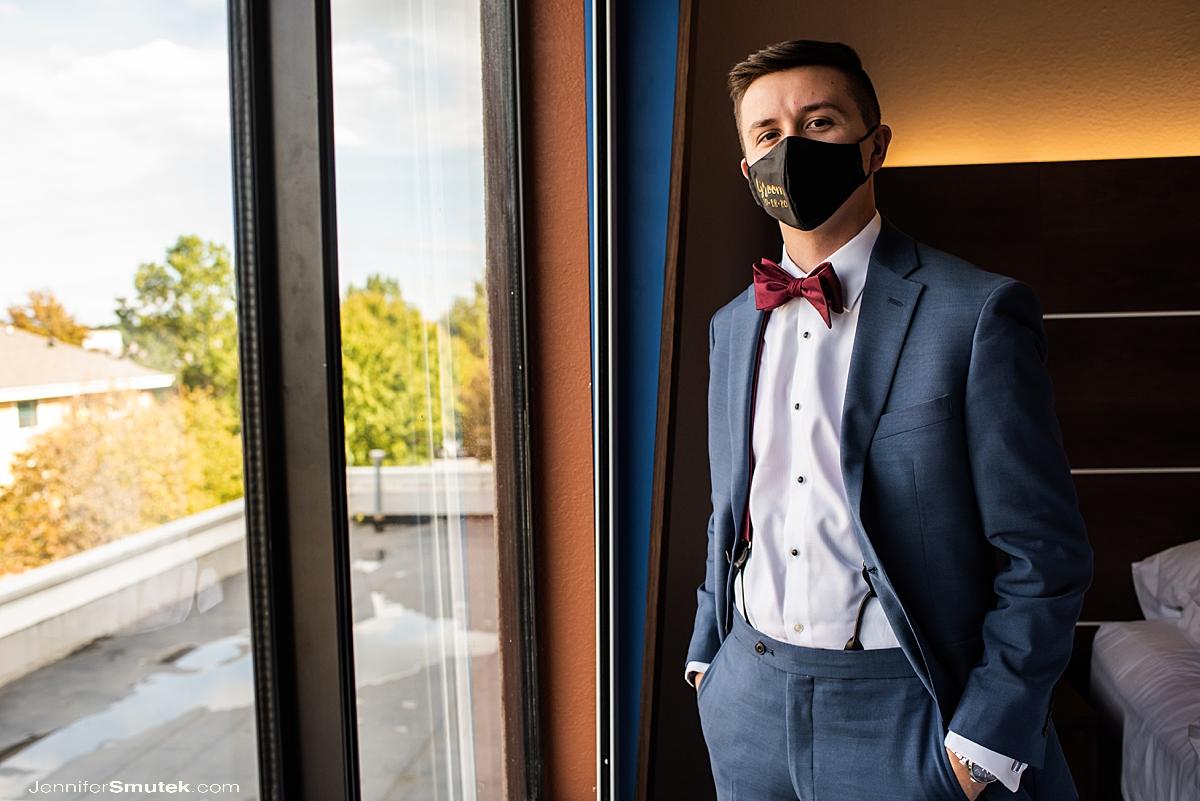 groom wearing mask covid wedding