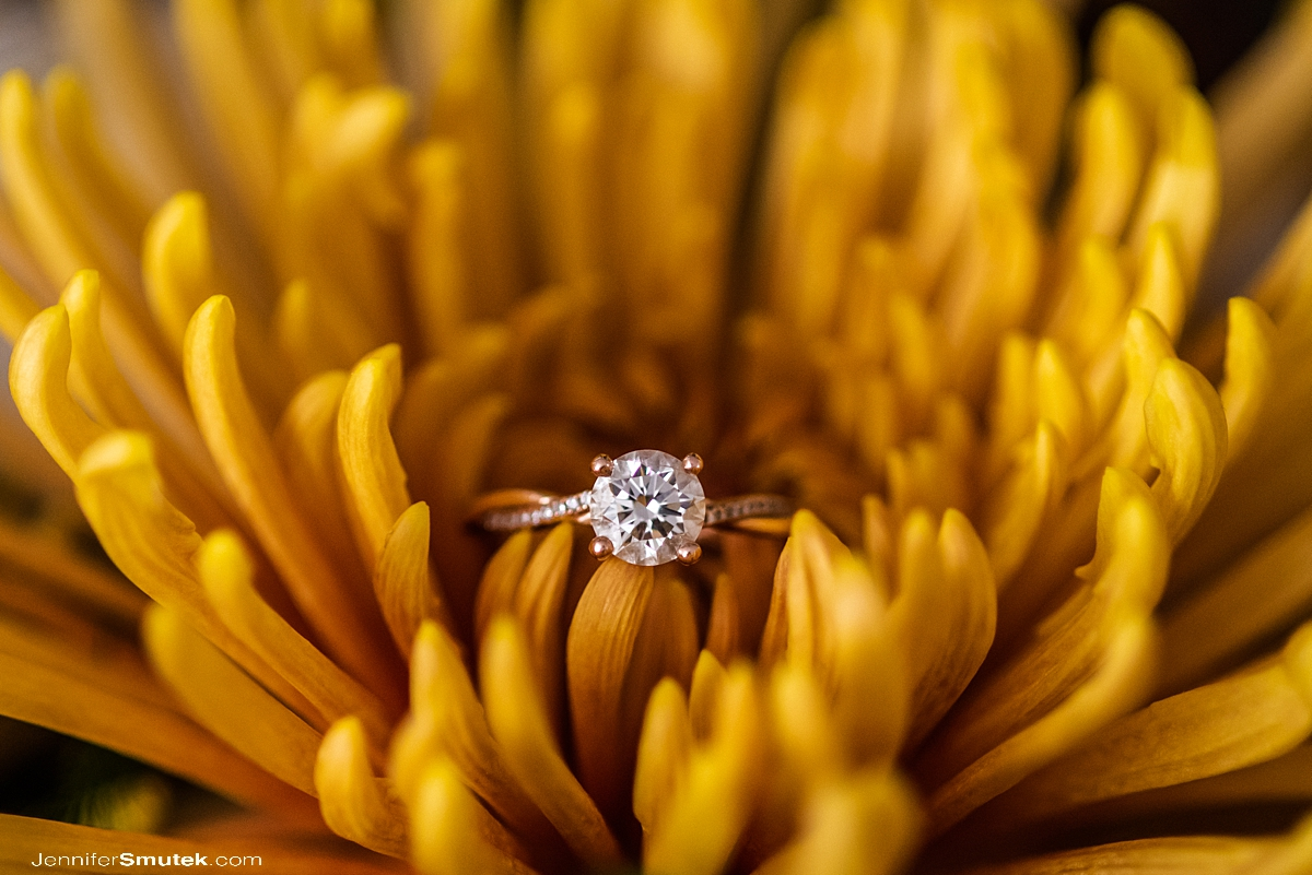 engagement ring in yellow flower