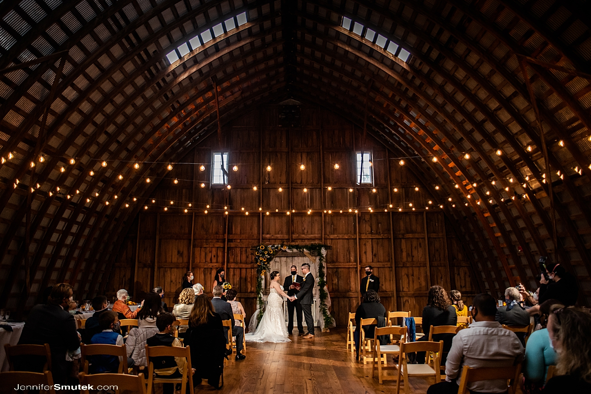Indoor ceremony barn at grimmel farms wedding