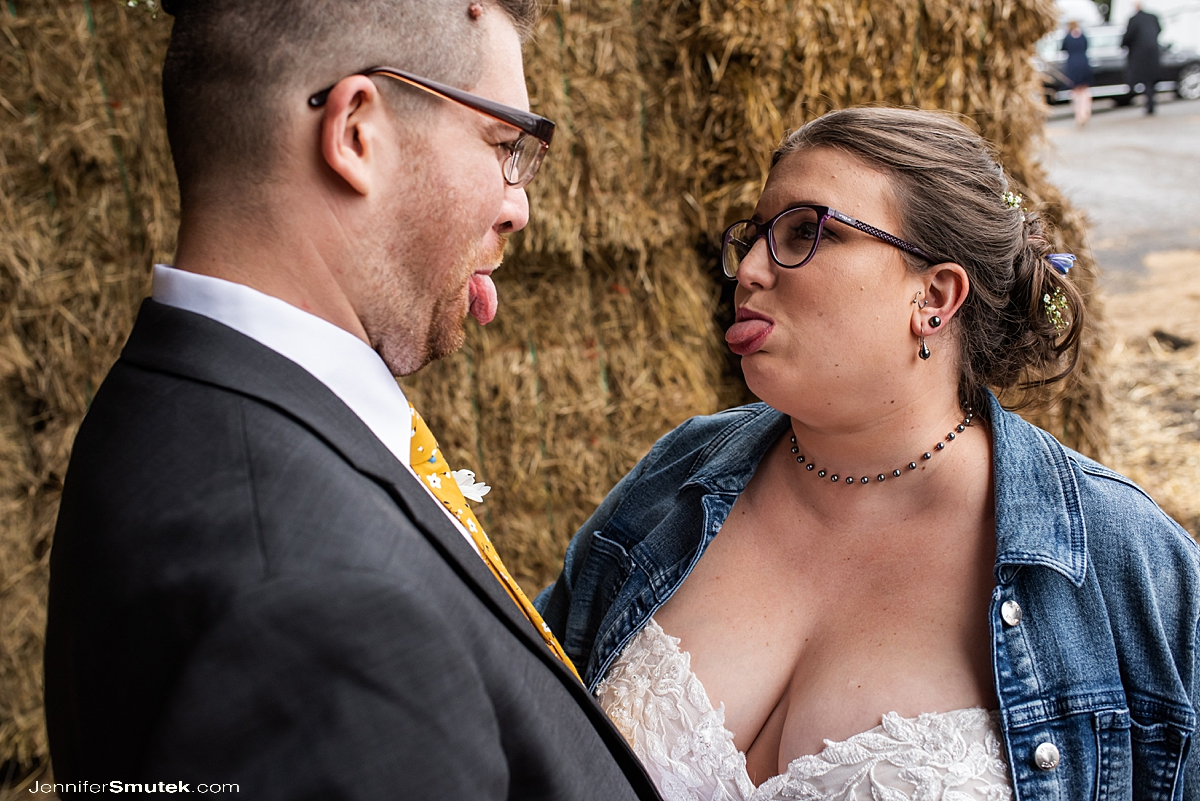 bride and groom sticking out tongue at one another first look