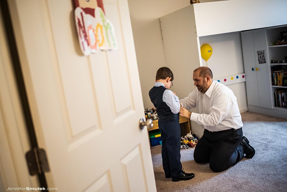 groom helping son get ready