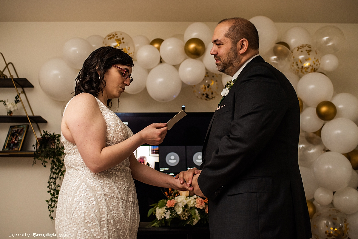 bride and groom reading vows Covid-Style Wedding at Home