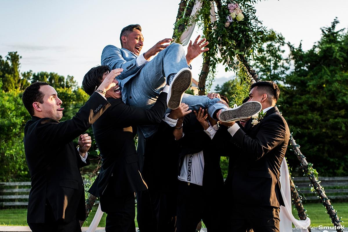groom getting thrown in air