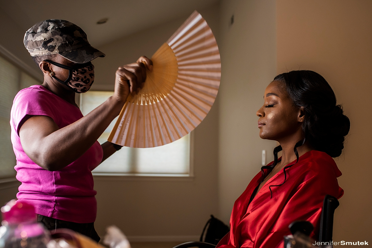 make up artist fanning a bride