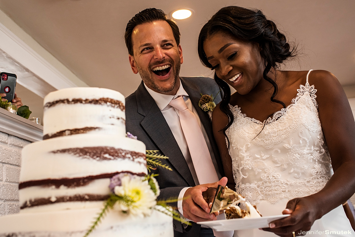 Titus Touch Music bride and groom cutting the cake