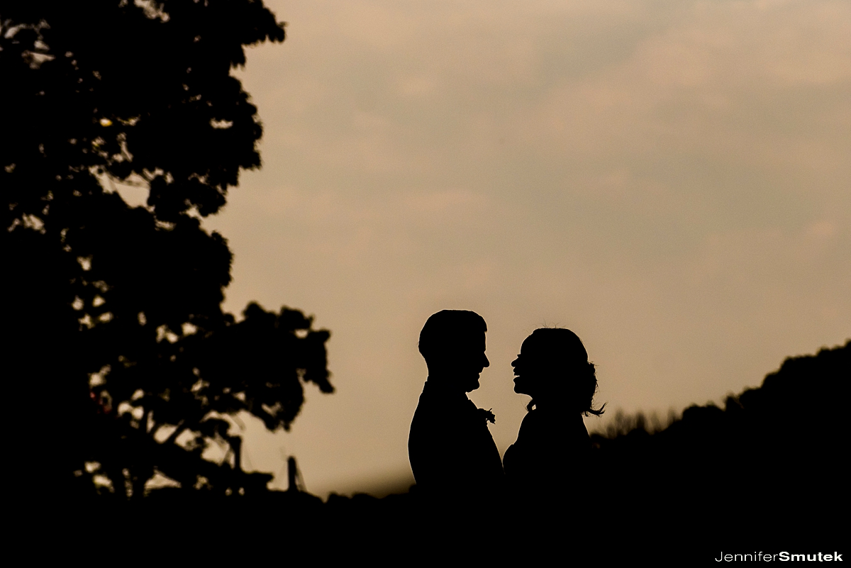 silhouette of bride and groom on a pier