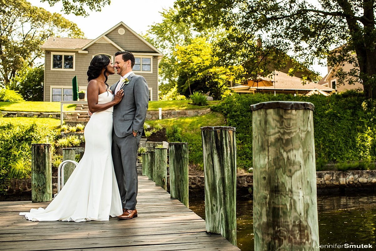 bride and groom on pier Maryland backyard wedding