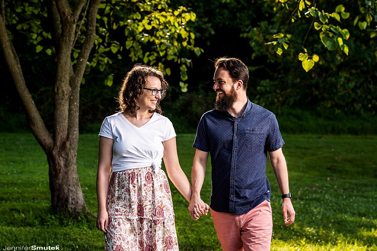couple walking centennial park engagement session