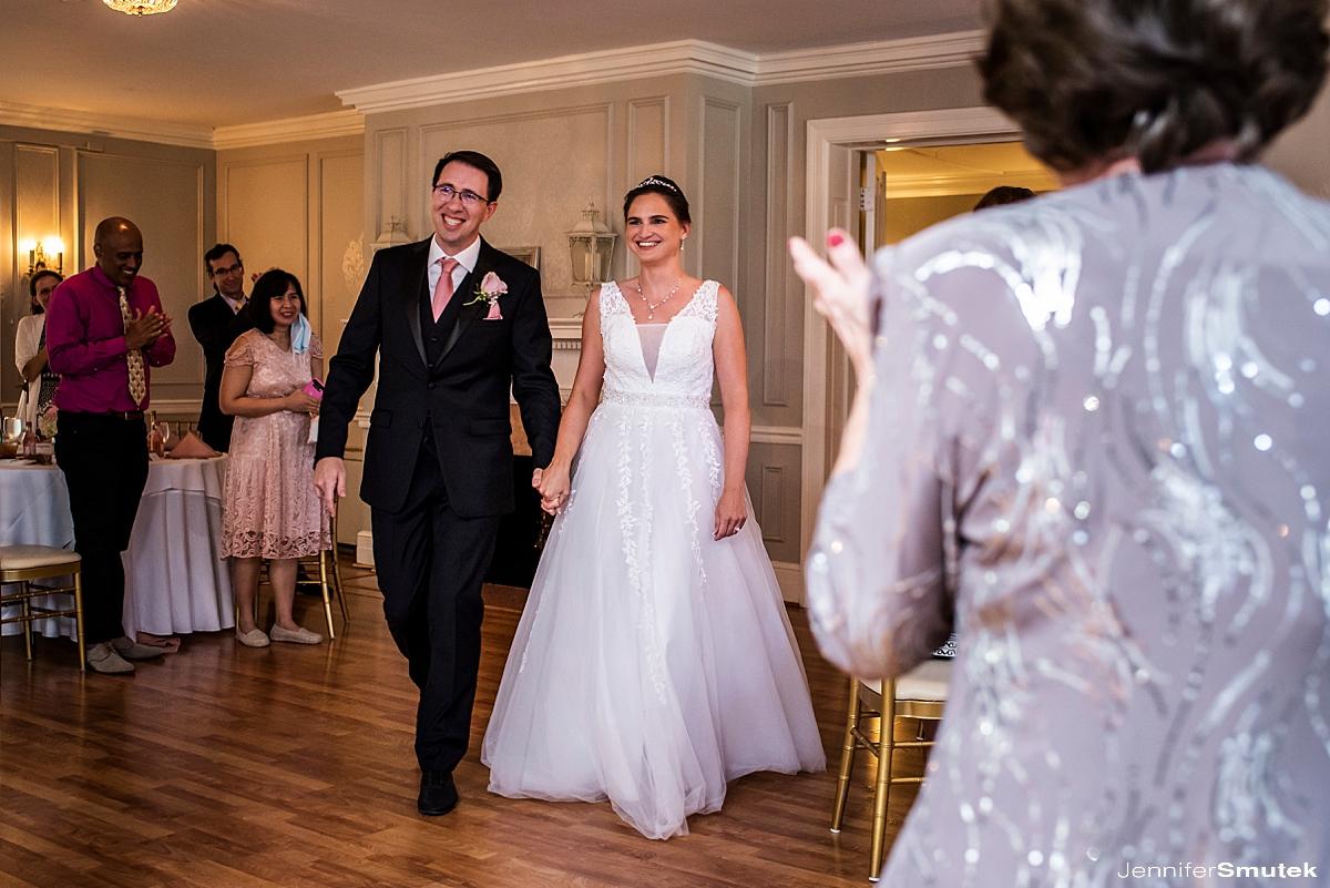 bride and groom entering room