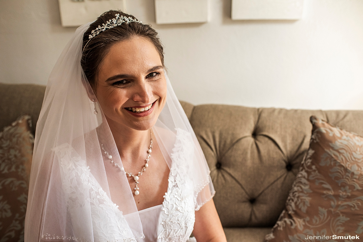 Bride sitting on couch Overhills Mansion Micro Wedding