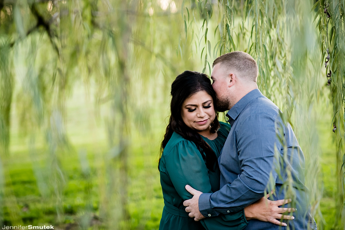 couple in willow tree Swan Harbor Farm Engagement Session